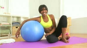 stock-footage-happy-black-woman-posing-with-exercise-ball