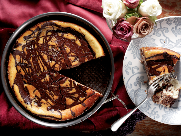 The recipe sent by Mrs SM de Lange of Port Elizabeth originally contained peanut butter. We used chopped nuts instead but the cheesecake with its chocolate swirls is so yummy you can leave out the nuts.