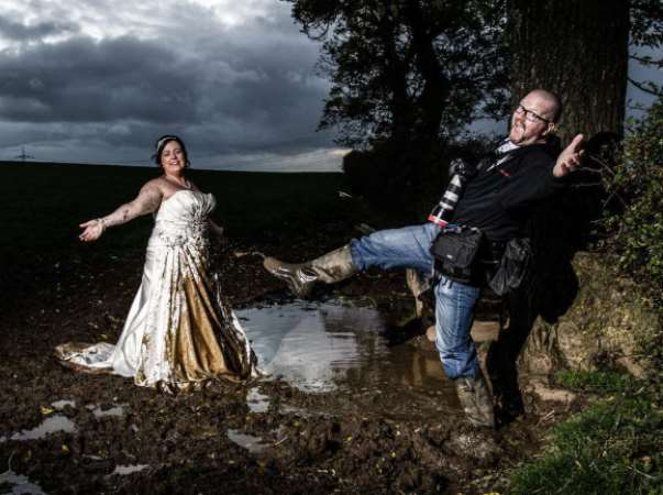 Regina captured her dad in action at a 'trash the dress shoot'. PHOTO: Wenn