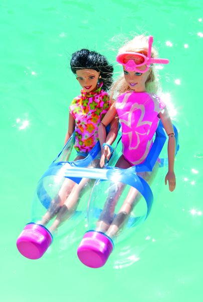 Boat from plastic water bottels containing 2 Barbie dolls