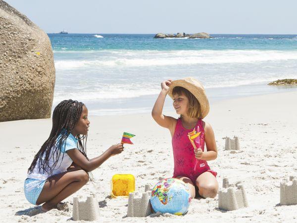 Girls building sand castles on the beach