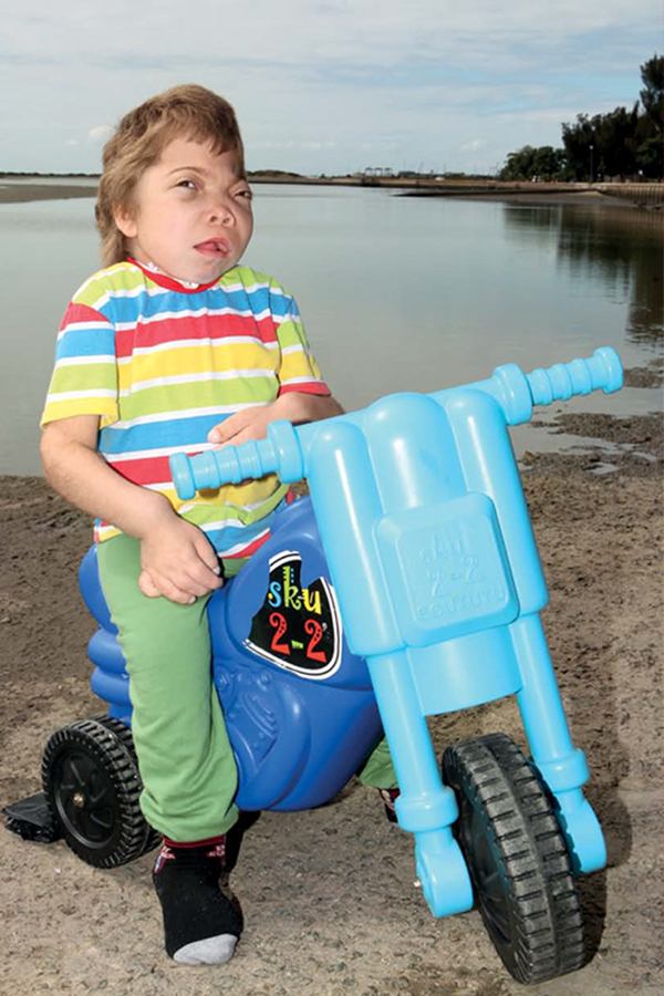 Jonathan rides his toy bike along the Swartkops River near his home in 2013. PHOTO: Corrie Hansen