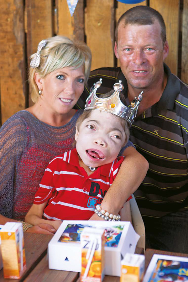 Jonathan Bezuidenhout, who has a rare genetic condition, celebrates his 12th birthday with his mom, Johleen Bezuidenhout, and her partner Quintin Carter. PHOTO: Misha Jordaan