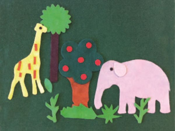 Giraffe and elephant on green felt board
