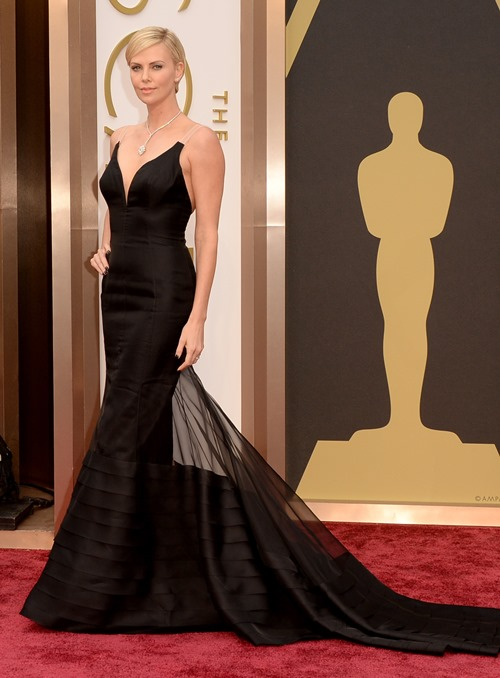 Our girl Charlize does us proud yet again.