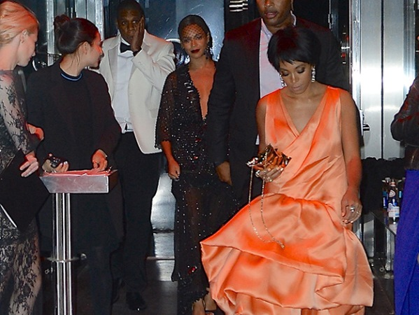 Beyonce looks serene just minutes after her sister Solange attacked Jay Z. Jay Z rubs his injured cheek. PHOTO: Bang Showbiz