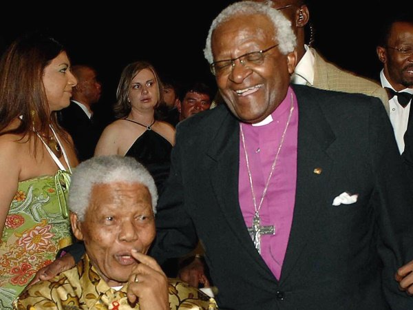 Anglican Archbishop Desmond Tutu, right, shares a light moment with  former South African President Nelson Mandela, sitting left, during Tutu's 75th birthday celebrations in Johannesburg, South Africa, Saturday, Oct. 7, 2006. (AP Photo/Rebecca Hearfield)