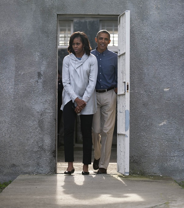 US President Barack Obama and his wife Michelle leave Nelson Mandela's cell during a visit to Robben Island on Sunday, 30 June 2013. Picture:Madelene Cronje/Mail&Guardian/Pool/SAPA