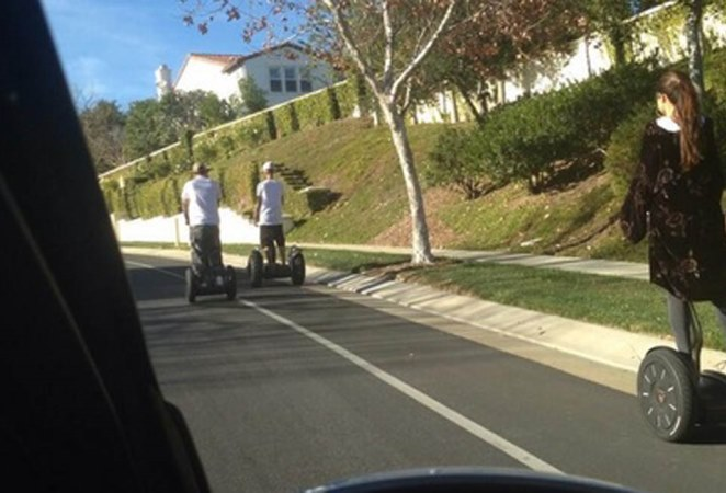 Justin and Selena take a segway ride in Justin's neighbourhood.