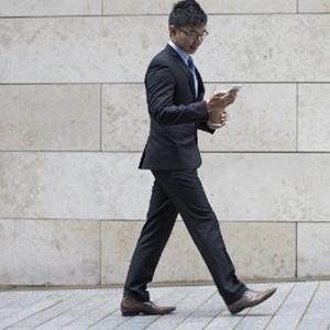 man walking while texting