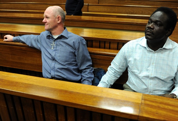 Andre Gouws and Ambrose Monye appear in the High Court on 11 September 2013. PHOTO: Werner Beukes/SAPA