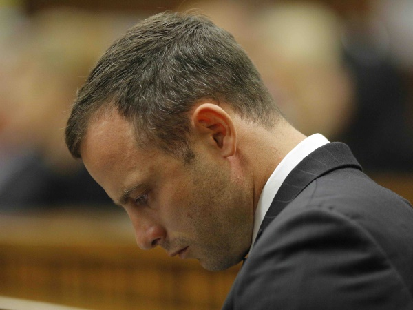 Oscar Pistorius sits quietly on his own after arriving at the High Court in Pretoria, South Africa on Tuesday, 4 March 2014. The court ruled that no photos or footage of Michelle Burger may be taken. PHOTO: Kim Ludbrook/EPA/Pool