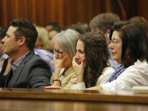 Aimee cries during her brother's testimony of events on the night that he killed Reeva. PHOTO: Kim Ludbrook/EPA/Pool
