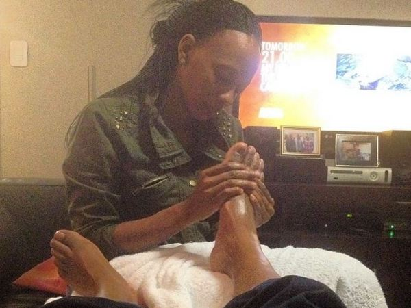 ProVerb is one lucky man, getting a foot massage from his wife Onalerona Thekisho. PHOTO: Instagram