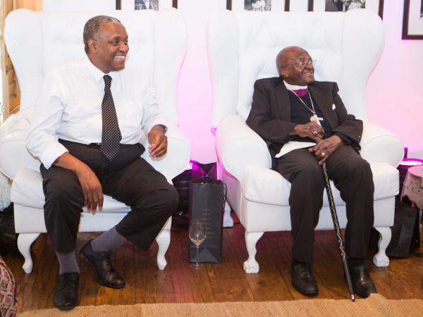 Tutu and his son, Trevor, watching the ceremony. PHOTO: Misha Jordaan