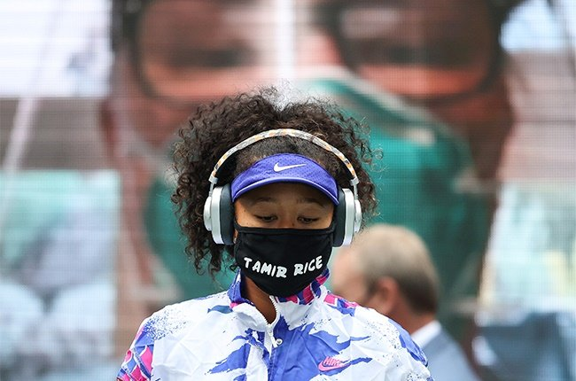 Naomi Osaka of Japan walks on court in front of virtual fans before her Womens Singles final match against Victoria Azarenka of Belarus on Day Thirteen of the 2020 US Open at the USTA Billie Jean King National Tennis Center on September 12, 2020 in the Queens borough of New York City.