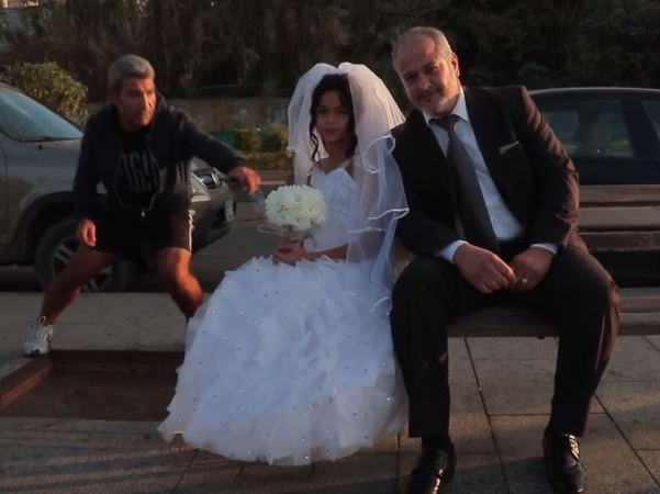"""A man tries to get the """"bride's"""" attention during the shoot. PHOTO: YouTube/Kafa"""