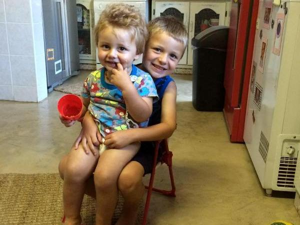 ero Stephan (6) with his brother, Markus (2), in his arms.