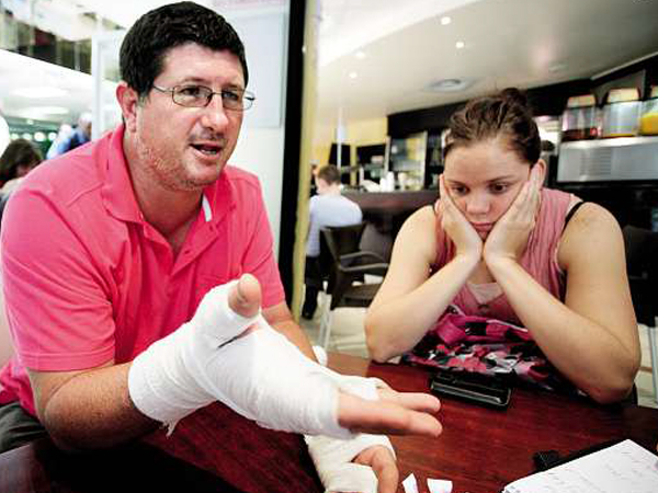 Erwin and Anicè at the hospital. His hands were burnt in the incident. PHOTO: Fani Mahuntsi