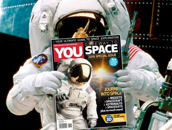 An astronaut holding the cover of YOU Gateway to Space