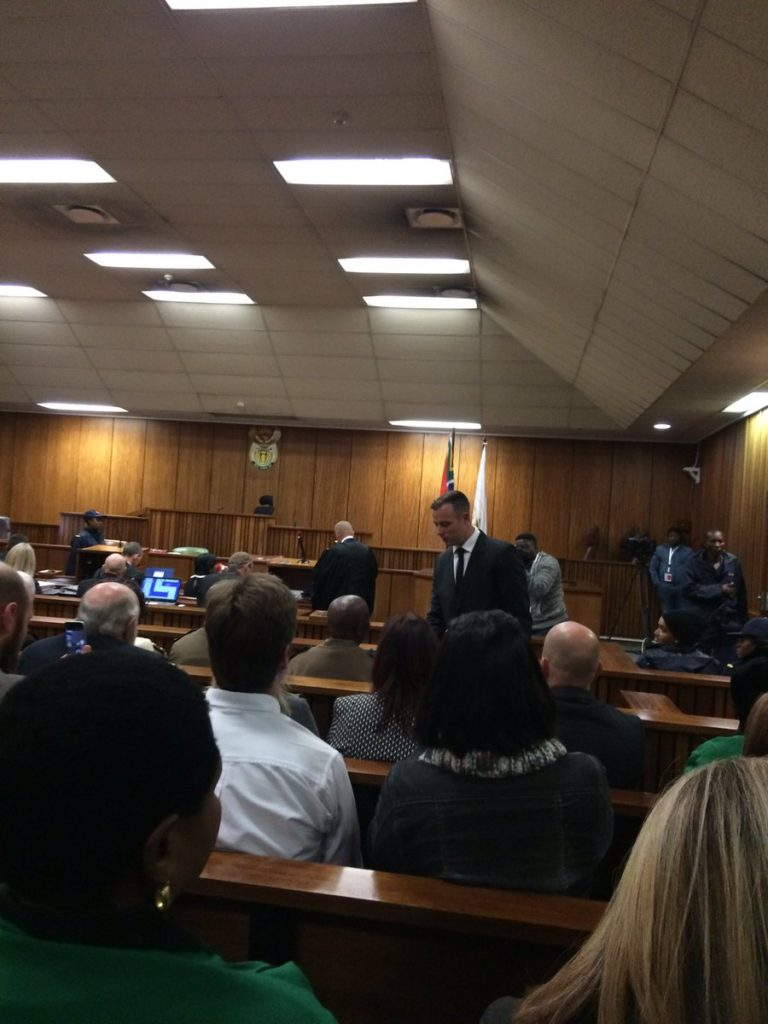A puffy-eyed Oscar Pistorius takes his seat in court. PHOTO: Jacques Myburgh