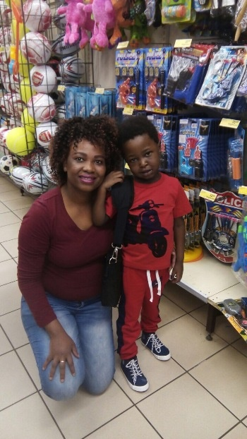 Mbalenhle Mndebele with her five-year-old son Mnotho, carrying his battery pack. An excited Mnotho recently went toy shopping with his mother after spending several months in hospital before and after his surgery.