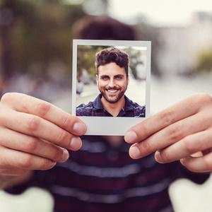 Man holding polaroid