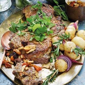 Tender roast lamb with potato kebabs
