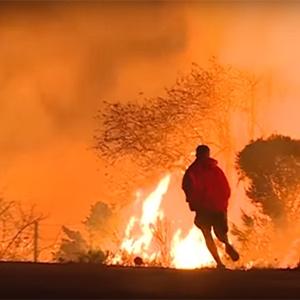 California wildfire burns 12 buildings, threatens hundreds