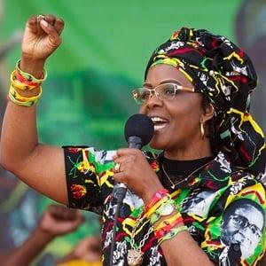 Zimbabwe's first lady, Grace Mugabe, greets supporters at a rally in July in Zimbabwe. (Tsvangirayi Mukwazhi/AP)