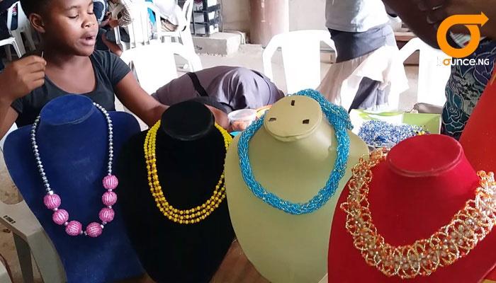 children learning bead making