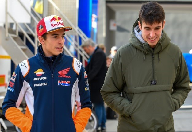 Repsol Honda Team Spanish rider Marc Marquez (L) and Repsol Honda Team Spanish rider Alex Marquez smile before pre-season testing, at the Ricardo Tormo racetrack, in Cheste near Valencia, on November 20. JOSE JORDAN / STR / AFP