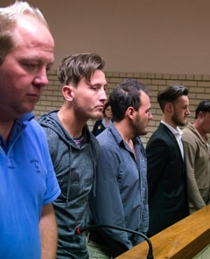 Stefan Nel, Dicky Junior van Rooyen, Marius Harding, Ockert Muller and Joshua Liam Scholtz stand in the Pretoria North Magistrate's Court, accused of assaulting a couple in a KFC drive through. (Deaan Vivier, Gallo Images, Netwerk24)