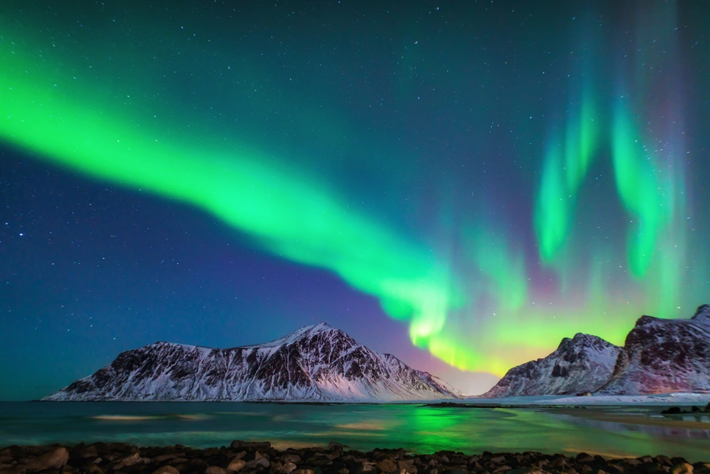 Mixed colorful aurora borealis dancing in the sky