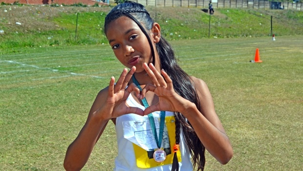 Newholme Primary School Grade 6 pupil Angelique Reddy (12) shows her delight at winning a bronze medal at an inter-school athletics competition at Northdale Stadium.