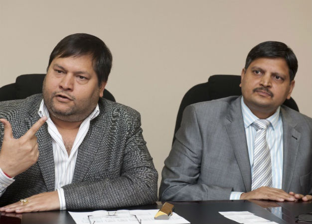 Indian businessmen, Ajay Gupta and younger brother