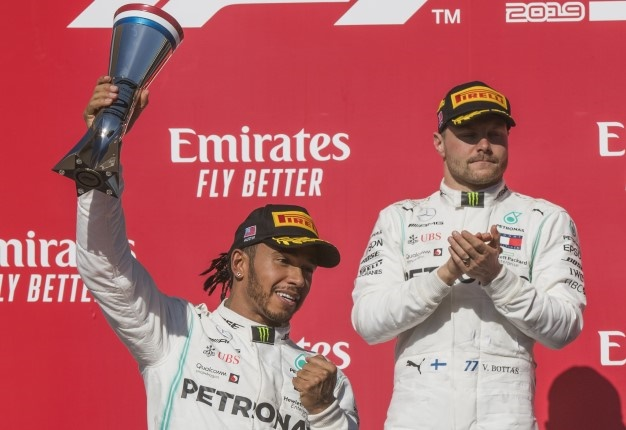 Lewis Hamilton reacts after being crowned World Champion during his second place finish, beside winner Valtteri Bottas of the Mercedes AMG at the F1 Grand Prix of USA at Circuit of The Americas in Austin Texas. <i> Image: Mark RALSTON / AFP