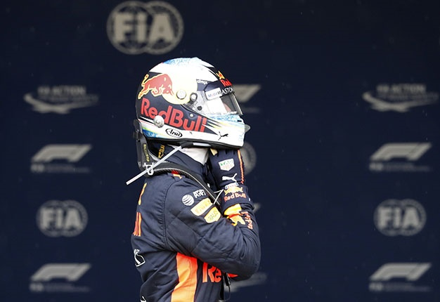 Daniel Ricciardo taking off helmet