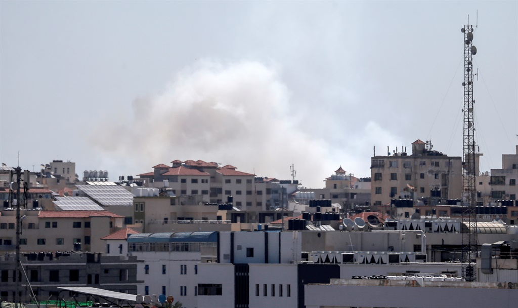 A picture taken from the Gaza Strip shows smoke billowing afters missiles were launched toward Israel. (Mahmud Hams, AFP)