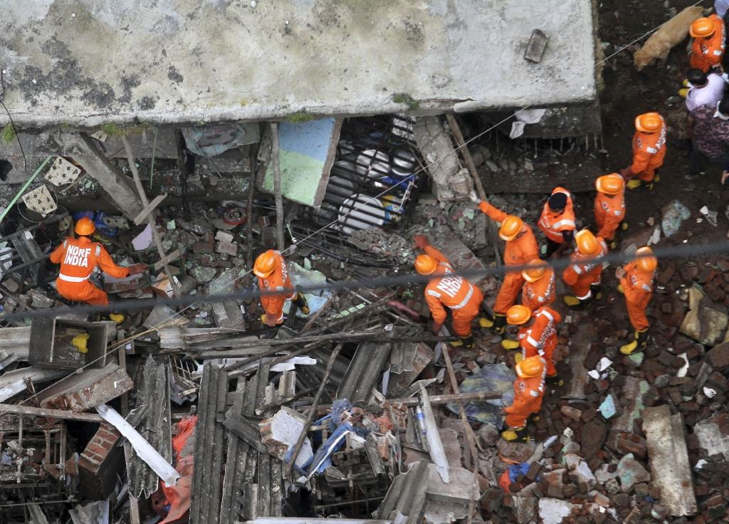 Rescue workers search for survivors in the rubble