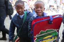 Learning gets a little easier as pupils receive DeskBags, play a bit of rugby