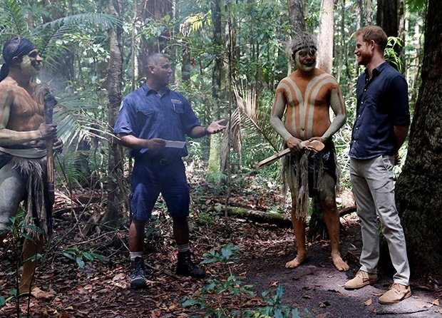 Prince Harry, Duke of Sussex stands next to Butchu