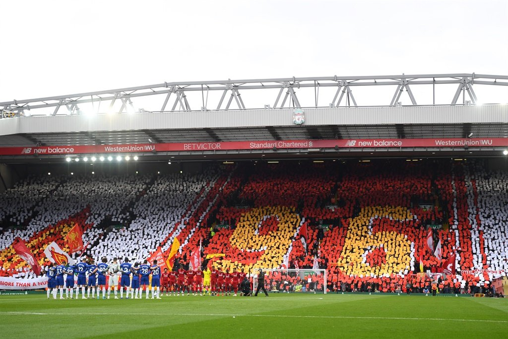 LIVERPOOL, ENGLAND - APRIL 14: Players and fans p