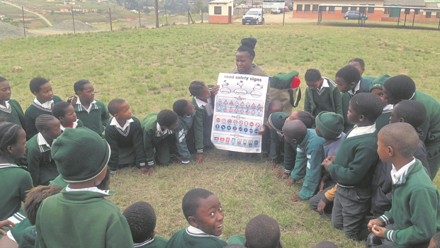 Teacher, or Bug, Zinhle Msimango conducts a road safety lesson, part of the life skills programme run by the Midlands Meander Education Project, at Haza Primary School in Merrivale, Howick.