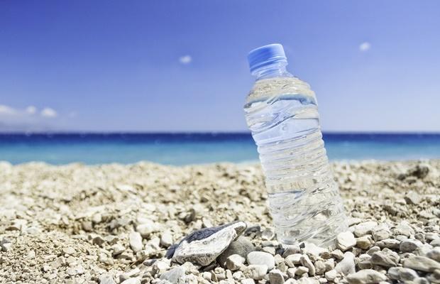 Water bottle on beach