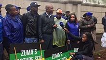 DA places 'capture site' signs outside the Gupta compound