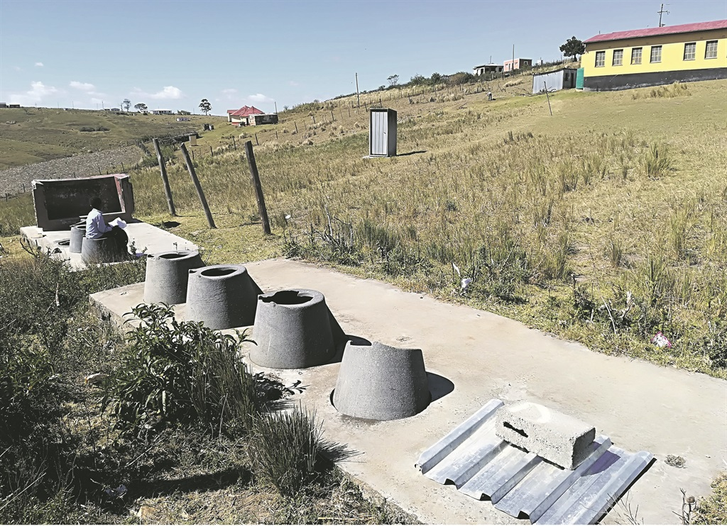 Pupils and teachers at Dalibango Primary School in the Eastern Cape either use these broken pit latrines or nearby bushes to relieve themselves. Picture: Lubabalo Ngcukana