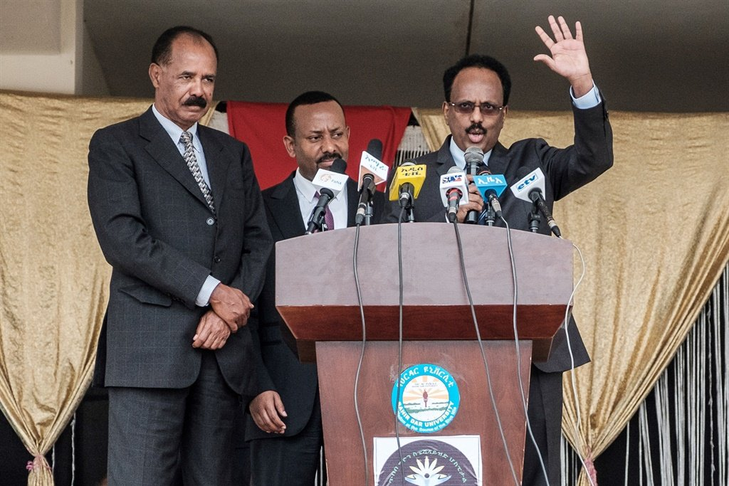 Somalia's president Mohamed Abdullahi Mohamed (R) makes a speech with Ethiopia's prime Minister Abiy Ahmed (C) and Eritrea's president Isaias Afwerki during the inauguration of the Tibebe Ghion Specialised Hospital in Bahir Dar, northern Ethiopia. (AFP)