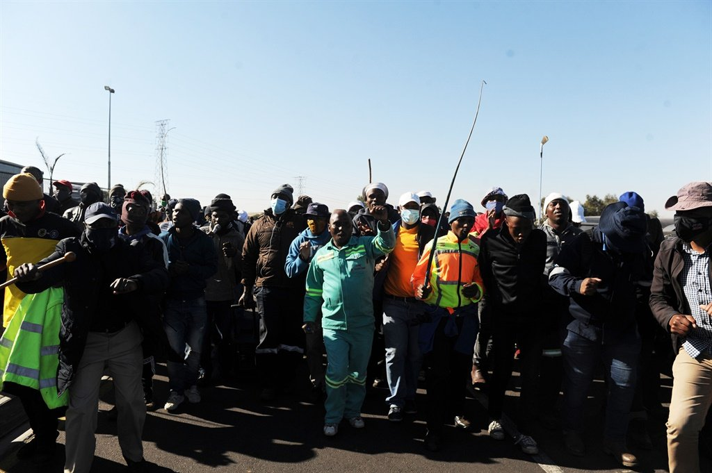Truck drivers slam a truck in an attempt to force drivers to park at City Deep Truck stop in Doornfontein, Johannesburg. South African truck drivers are protesting against the employment of foreign nationals. Picture: Rosetta Msimango/City Press