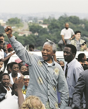 Peacemaker: ANC leader Nelson Mandela greets supporters during his election campaign in Durban, 1994. Picture: Tom Stoddart archive / Getty Images